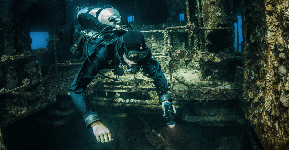 Wreck diver in single tank BC wing